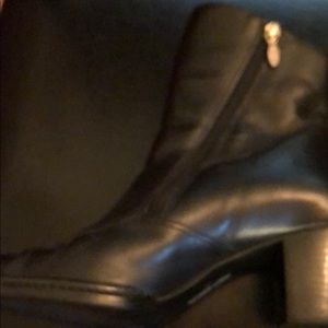 Women's black leather boots.